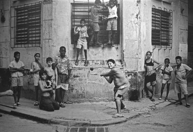 http://commons.wikimedia.org/wiki/File:Boys_Playing_Stickball,_Havana,_Cuba,_1999.jpg