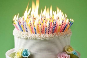 picture-of-a-birthday-cake-with-lots-of-candles-300x200