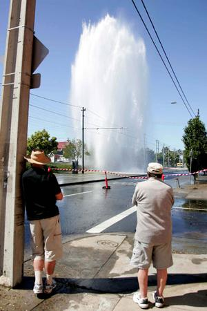 Water sprays sky-high from a burst water mains pipe in Melbourne.
